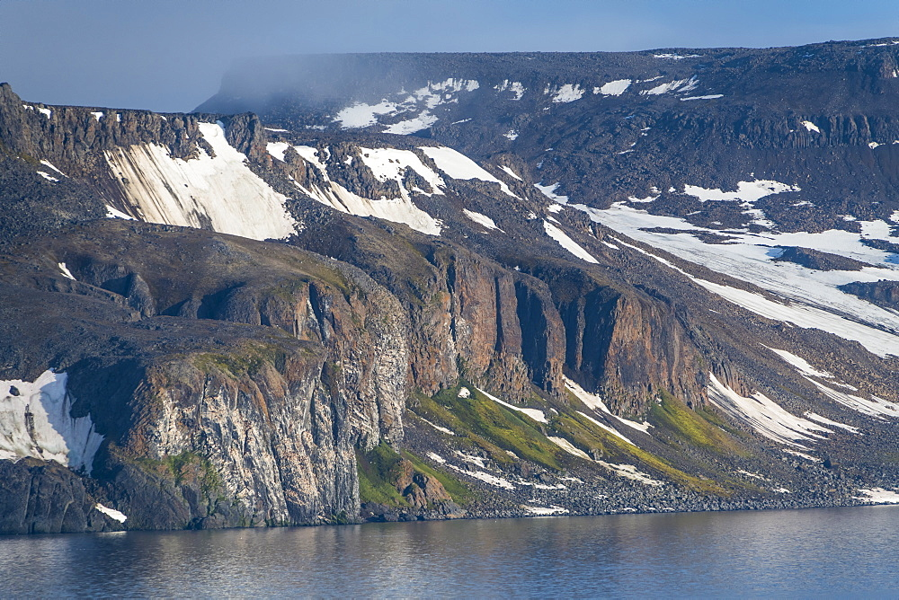 Green cliff in the glacier covered mountains of Franz Josef Land archipelago, Arkhangelsk Oblast, Arctic, Russia, Europe