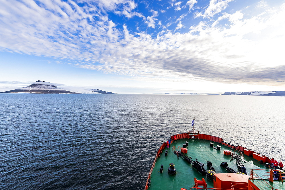 Icebreaker cruising through the flat table mountains covered with ice, Franz Josef Land archipelago, Russia - 1184-2866
