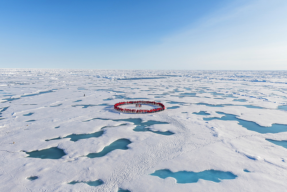 People forming a circle to memorise to have arrived on the North Pole, Arctic