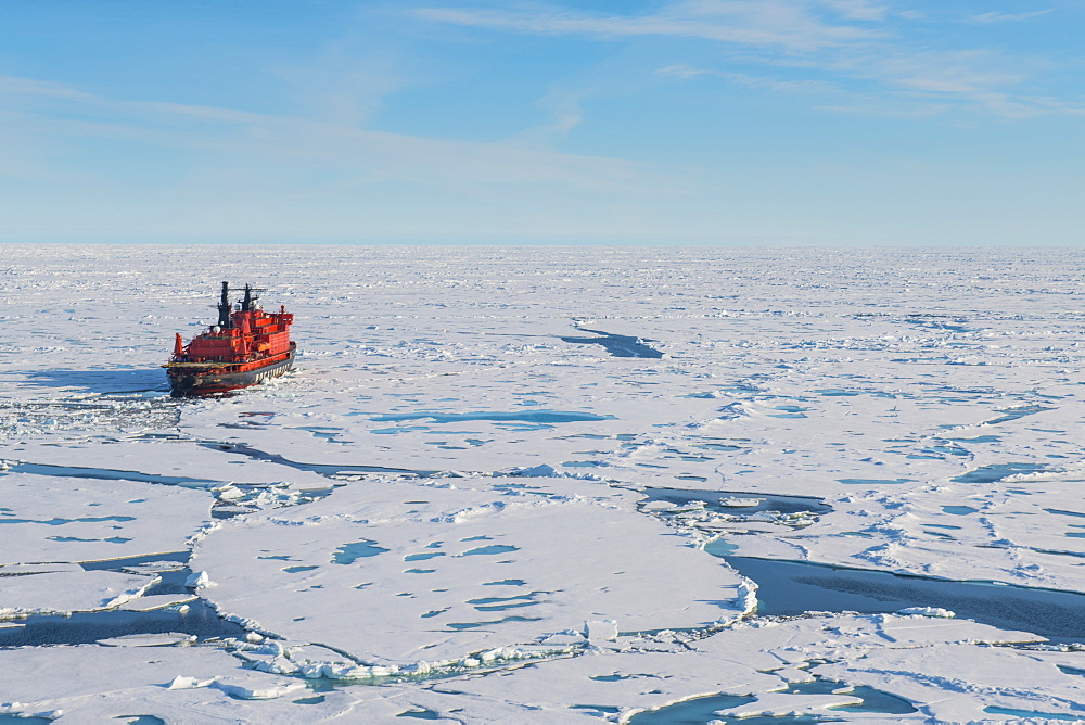Aerial of the Icebreaker '50 years of victory' on the North Pole through the window of a helicopter, Arctic