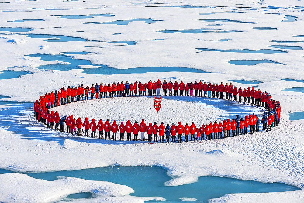 People forming a circle to memorise to have arrive on the North Pole, Arctic