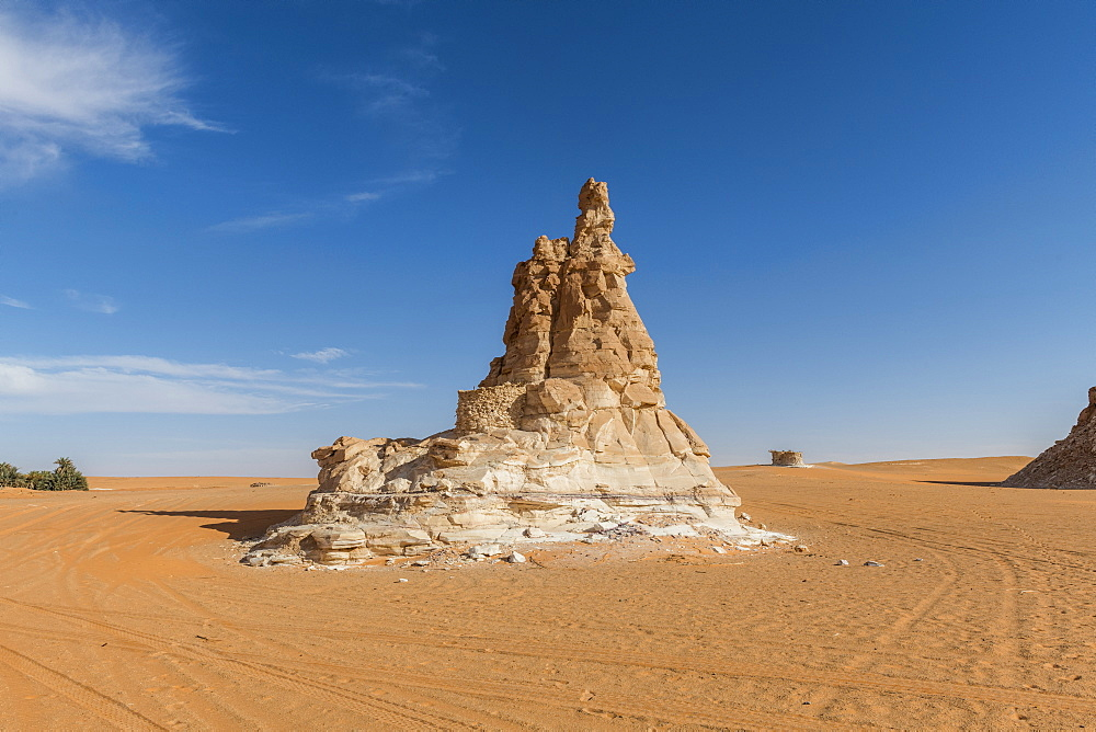 Sandstone tower at a Salt water lake in Northern Chad, Africa