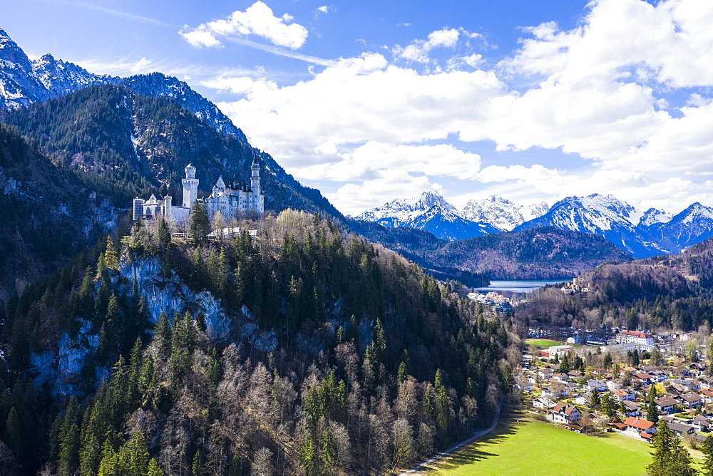 Aerial of Castle Neuschwanstein, with the Alps behind, Schwangau, Bavaria, Germany, Europe