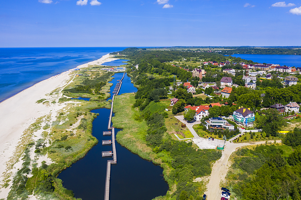 Aerial of a boardwalk in a little lake on the coast of Yantarny, Kaliningrad, Russia (drone)
