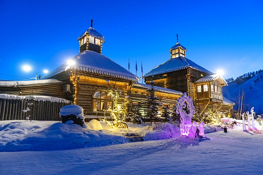Beautiful traditional wooden house after sunset, Yakutsk, Sakha Republic (Yakutia), Russia, Eurasia