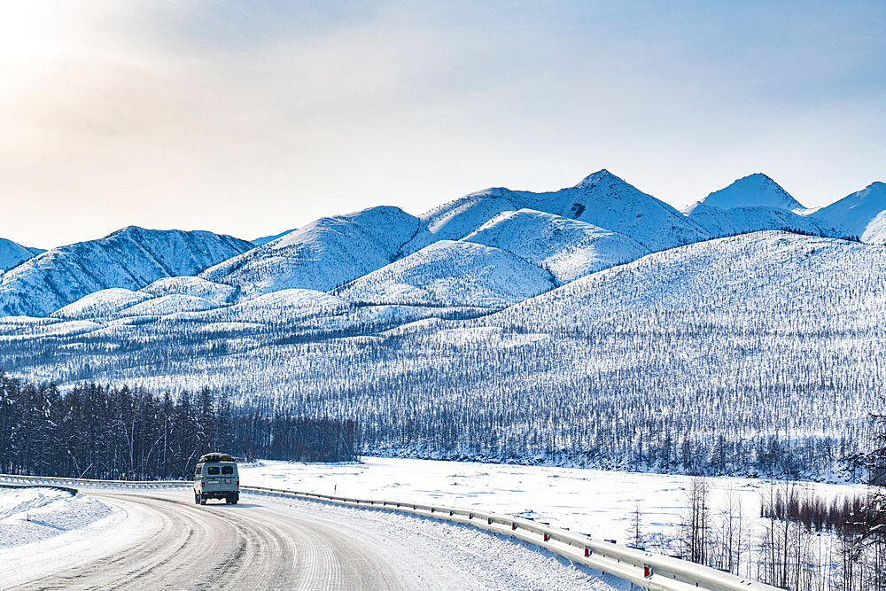 Minivan driving on the Road of Bones, Suntar-Khayata Range, Sakha Republic (Yakutia), Russia, Eurasia