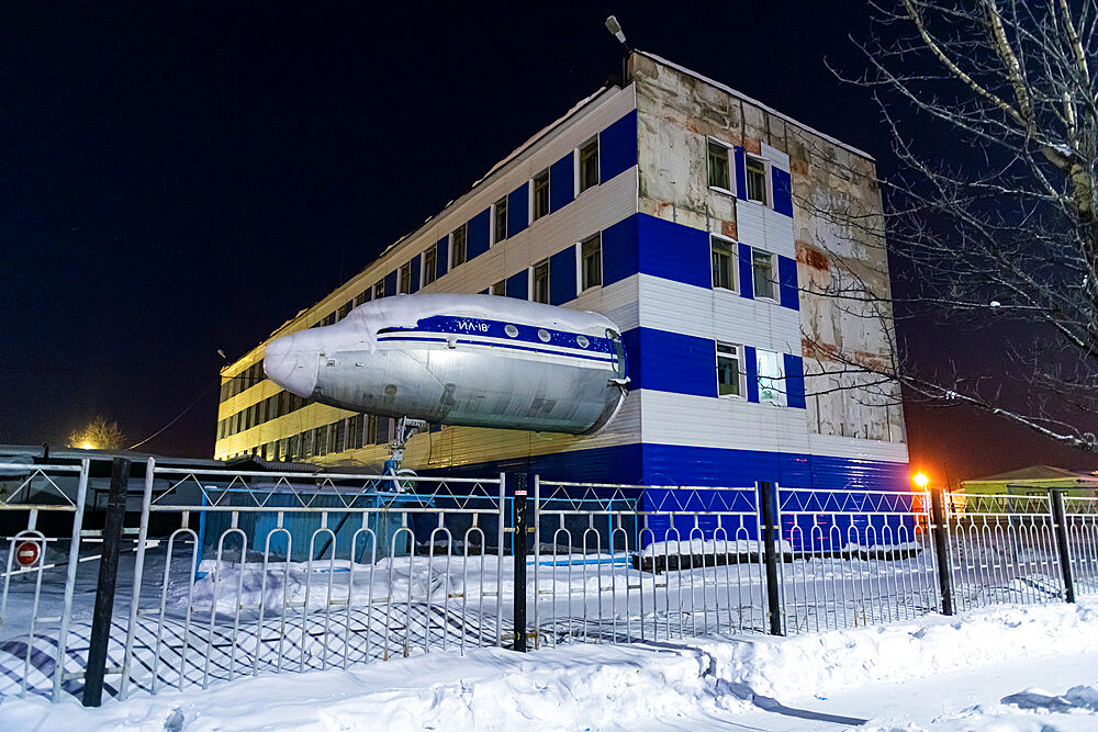 Airplane sticking out of a building, Susuman, Road of Bones, Magadan Oblast, Russia, Eurasia