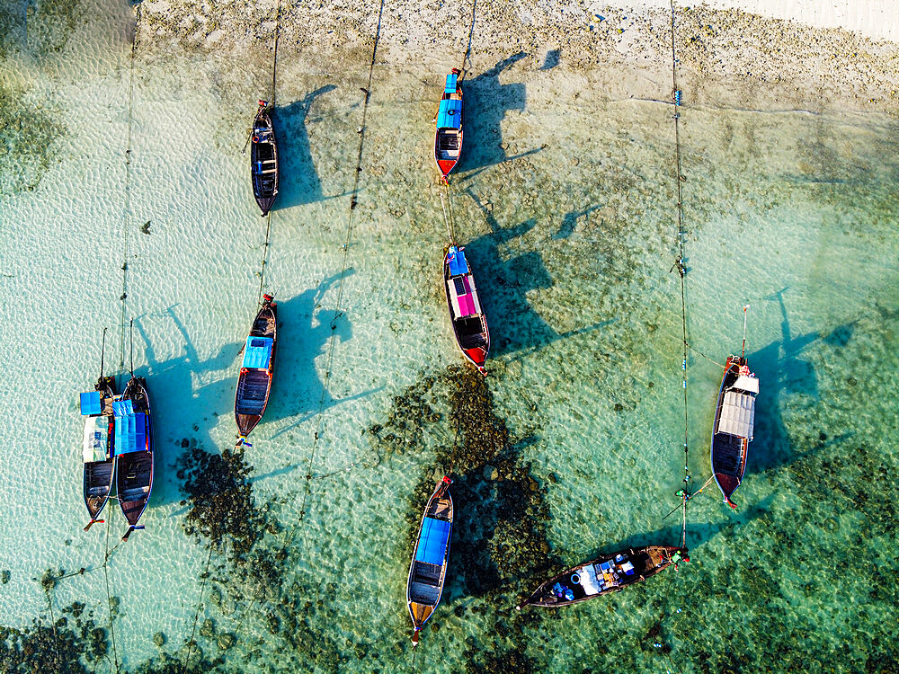 Aerial of fishing boats in the waters of Koh Lipe, Tarutao National Park, Thailand, Southeast Asia, Asia