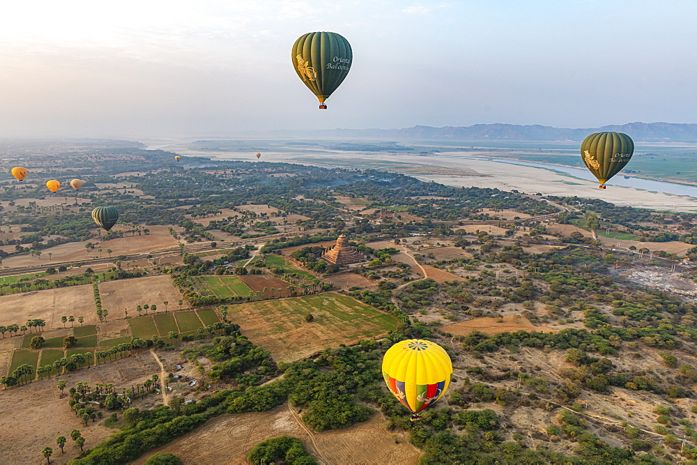 Hot air balloon at sunrise over temples of Bagan (Pagan), Myanmar (Burma), Asia