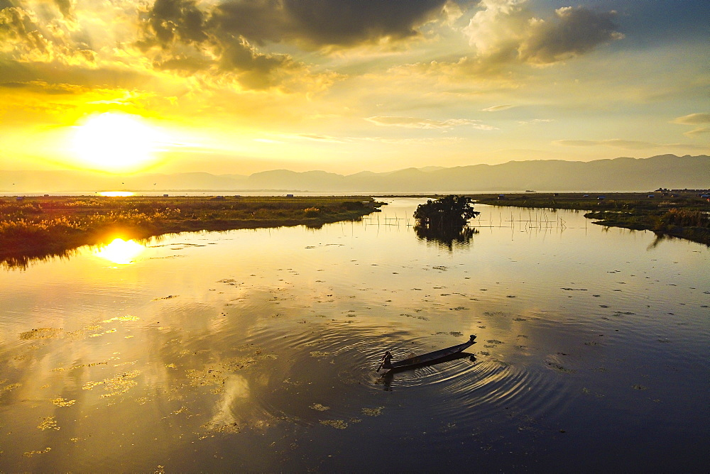 View by drone of rowing boat at sunset, Inle Lake, Shan state, Myanmar (Burma), Asia