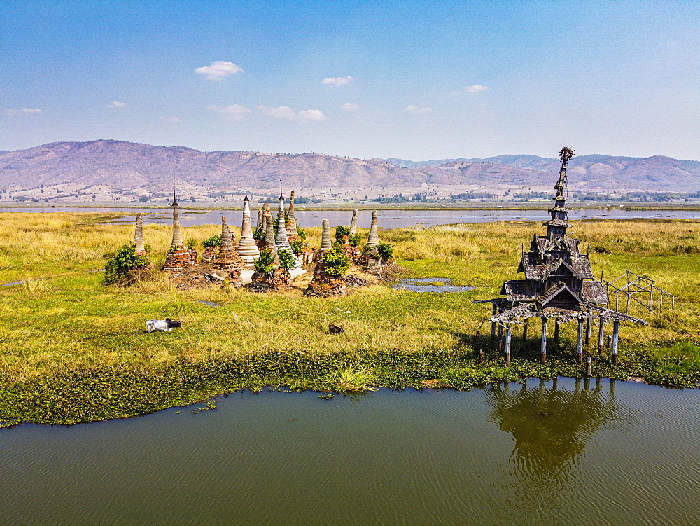 Aerial by drone of little pagodas sitting in the waters of the southern Inle Lake, Nyaungshwe, Shan state, Myanmar (Burma), Asia