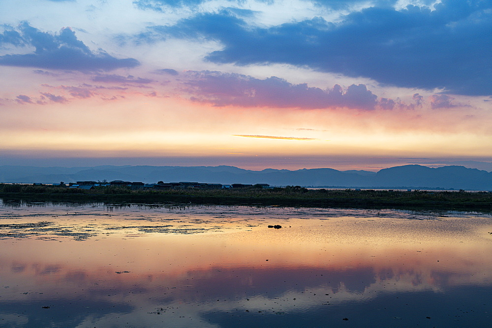 Clouds reflecting in the water at sunset, Inle Lake, Shan state, Myanmar (Burma), Asia