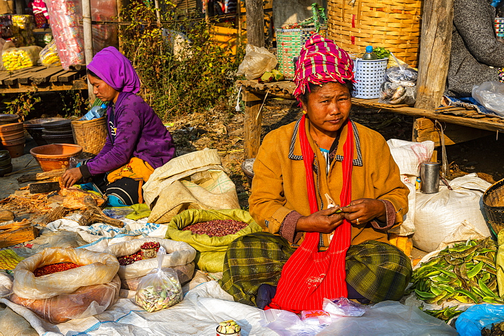 Tribal women selling vegetables at the Market of Inn Thein, Inle Lake, Shan state, Myanmar (Burma), Asia