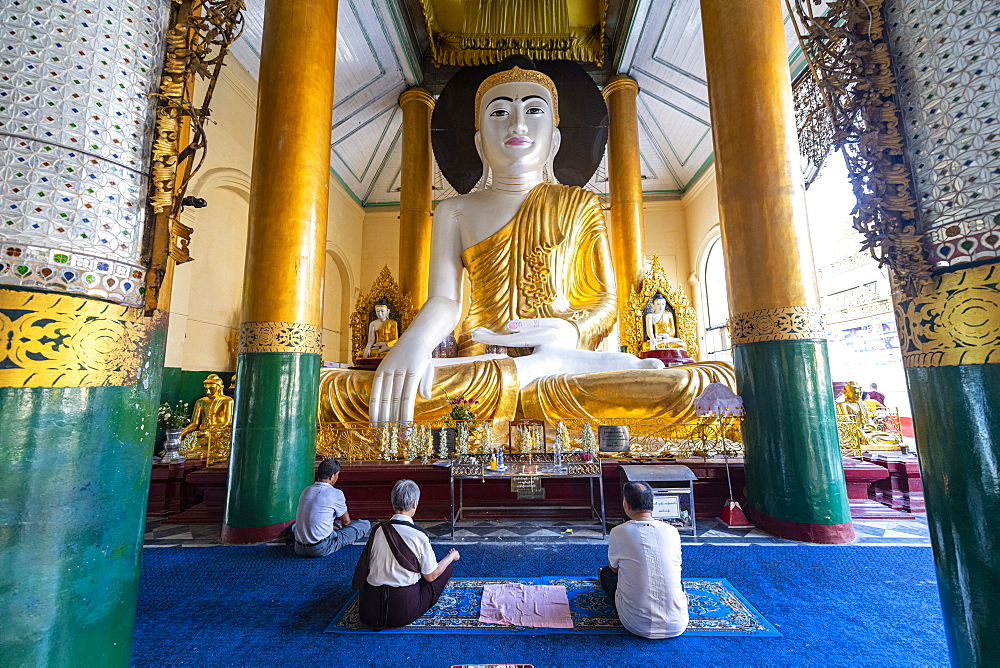 Pilgrims praying in the Shwedagon pagoda, Yangon (Rangoon), Myanmar (Burma), Asia