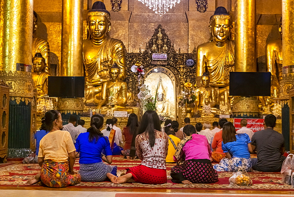 Pilgrims in the Shwedagon pagoda, Yangon (Rangoon), Myanmar (Burma), Asia