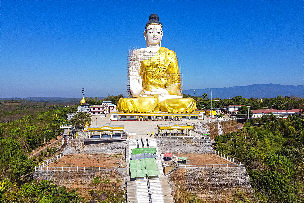 Aerial of a giant sitting Buddha below the Kyaiktiyo Pagoda (Golden Rock), Mon state, Myanmar (Burma), Asia