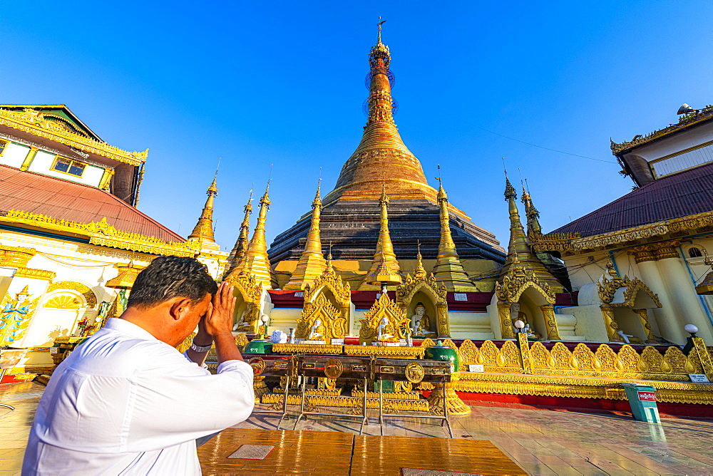 Man praying in the Kyaikthanian paya, Mawlamyine, Mon state, Myanmar (Burma), Asia