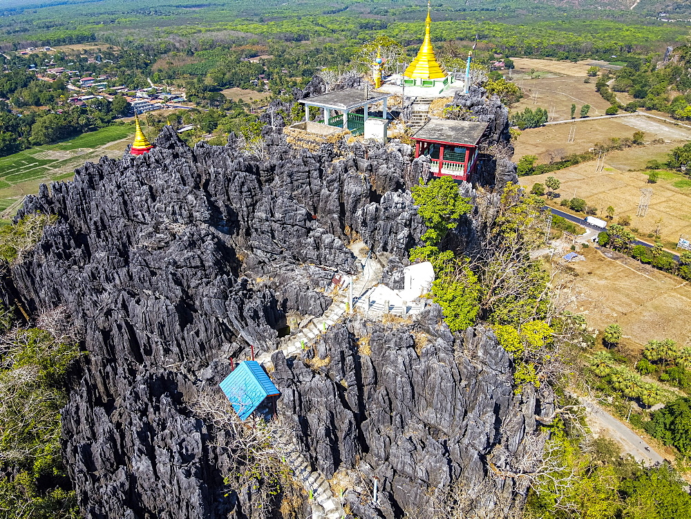 Aerial by drone of Kyauktalon Taung crag with a Hindu temple, near Mawlamyine, Mon state, Myanmar (Burma), Asia