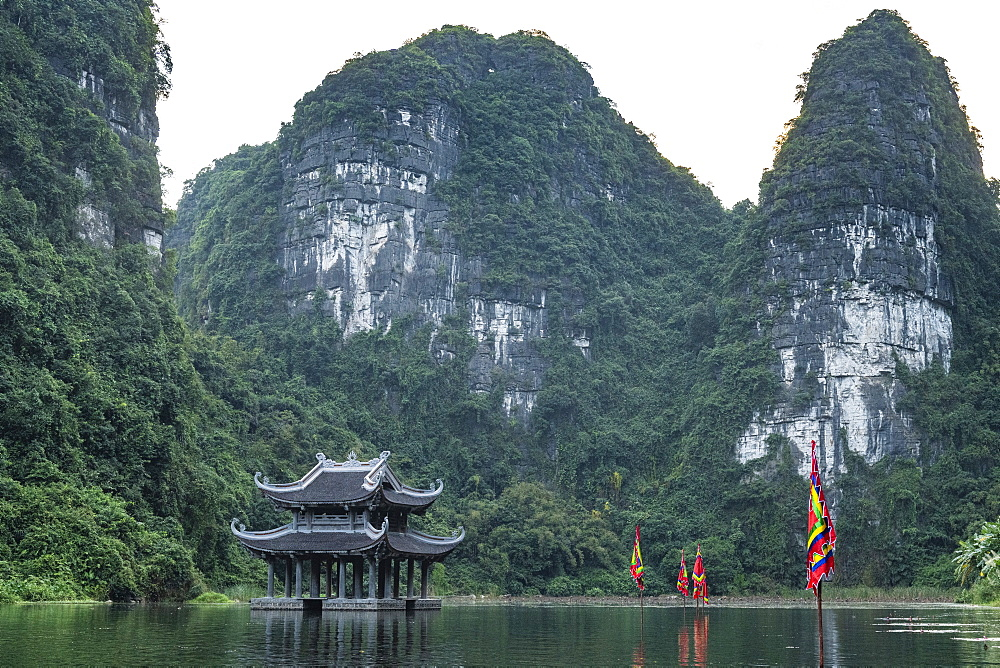 Temple standing between the scenic limestone mountains of Trang An Landscape Complex, UNESCO World Heritage Site, Vietnam, Indochina, Southeast Asia, Asia