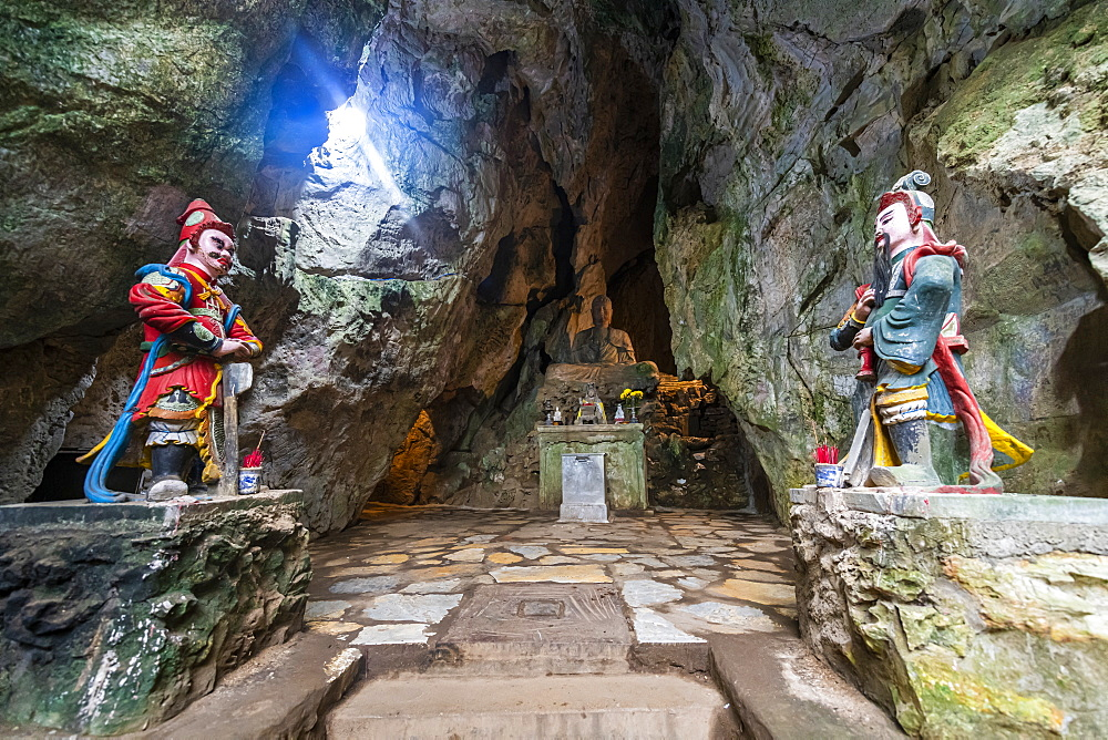 Soldier statues at the entrance to a cave in the Marble 