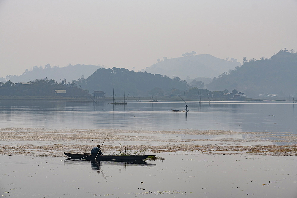 Fisherman in his canoe fishing, Loktak Lake, Moirang, Manipur, India, Asia