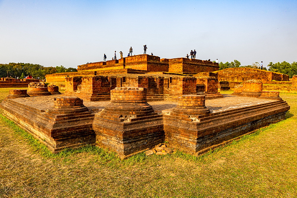 Locals posing on the Buddhist monuments of Mainamati, Bangladesh