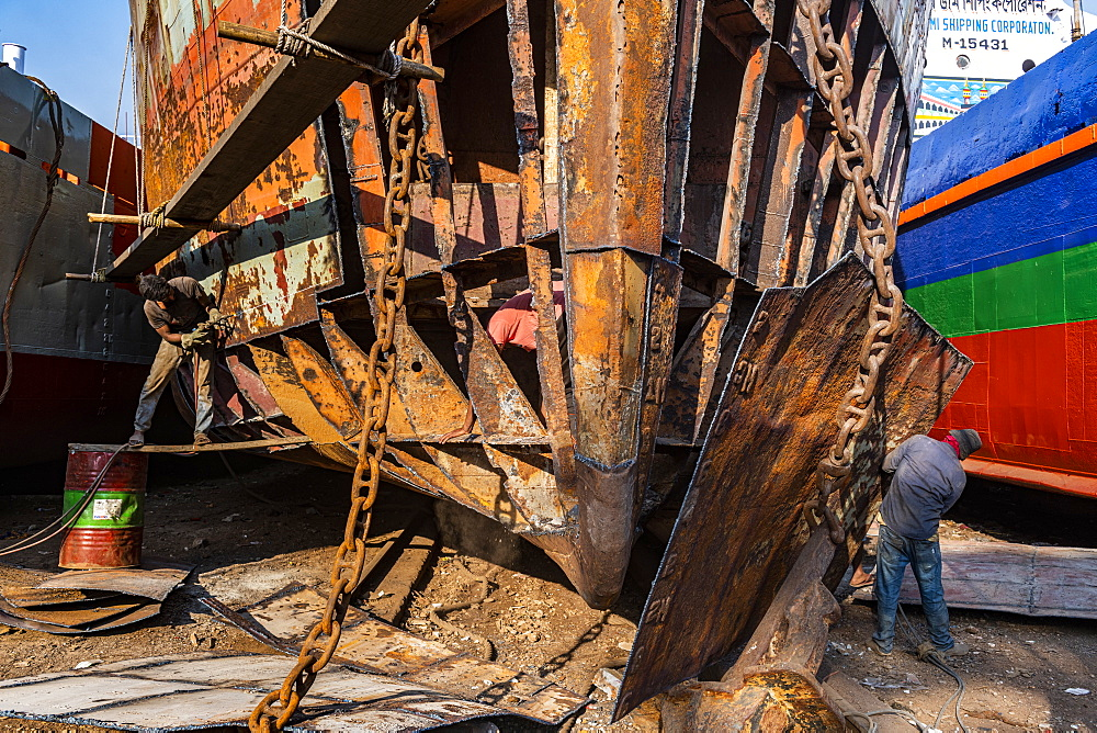 Men at an open boat, shipwreck cemetery (ship breaking yard), Port of Dhaka, Bangladesh, Asia