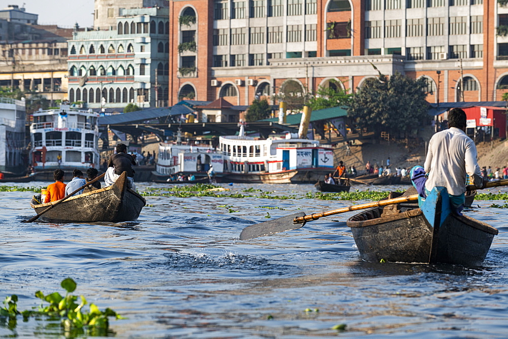 Man rowing his canoe, Port of Dhaka, Bangladesh, Asia