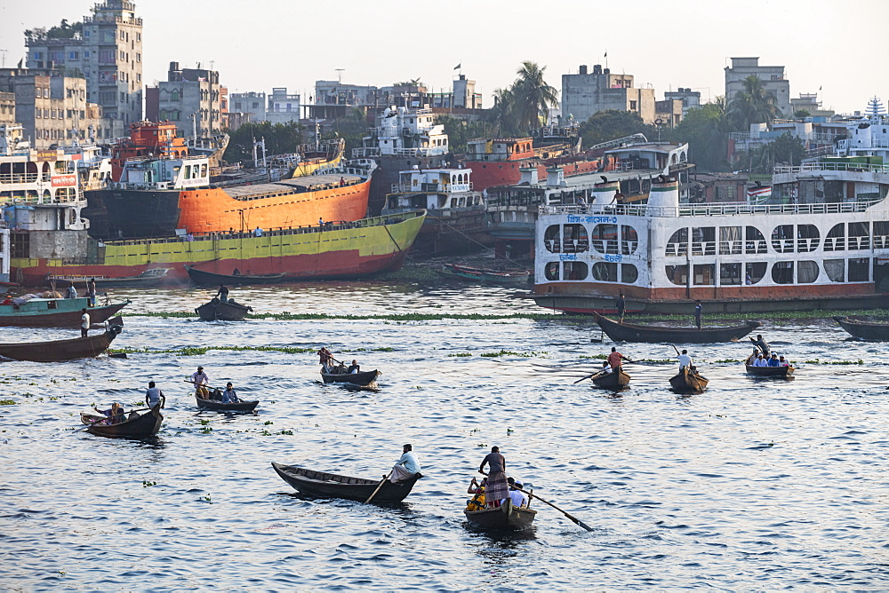 Passenger Canoes in the port of Dhaka in front of a passenger ferry, Dhaka, Bangladesh, Asia