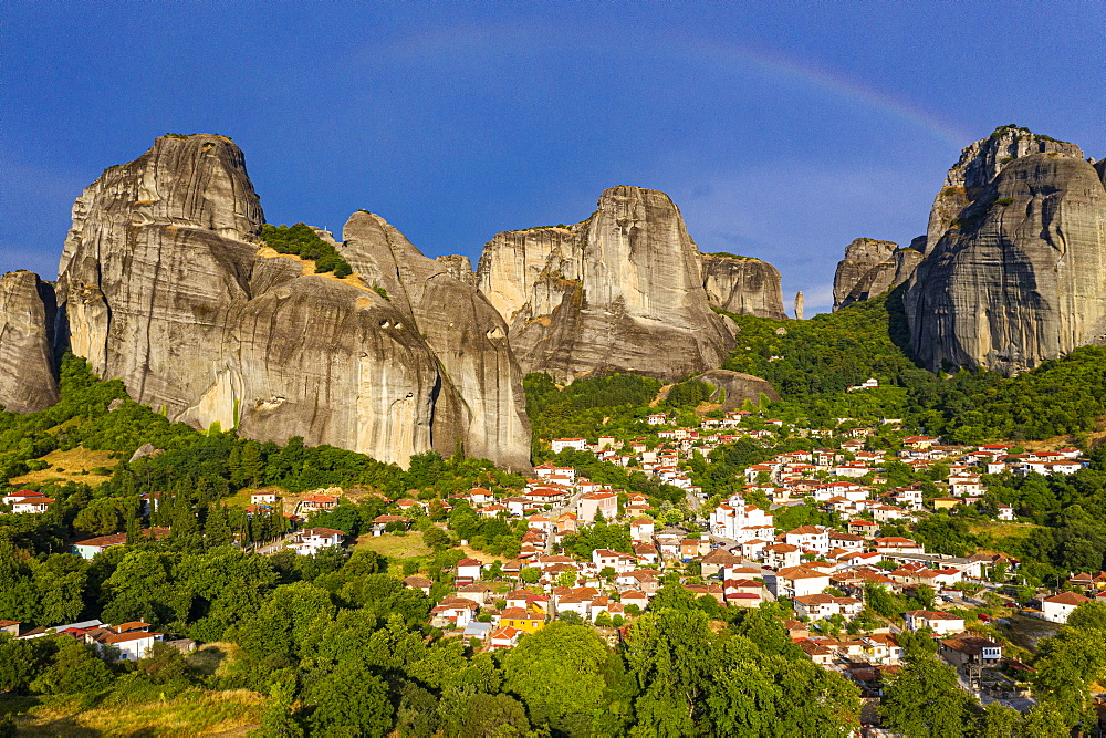 Aerial of the village of Kastraki in the huge rocks of the Unesco world heritage site Meteora monateries, Greece (drone) - 1184-4440