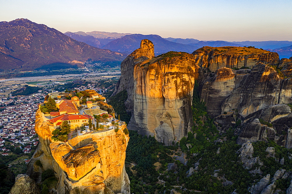 Aerial of the Holy Monastery of Holy Trinity at sunrise, Unesco world heritage site Meteora monateries, Greece (drone) - 1184-4442