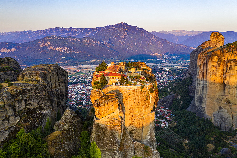 Aerial of the Holy Monastery of Holy Trinity at sunrise, Unesco world heritage site Meteora monateries, Greece (drone) - 1184-4443