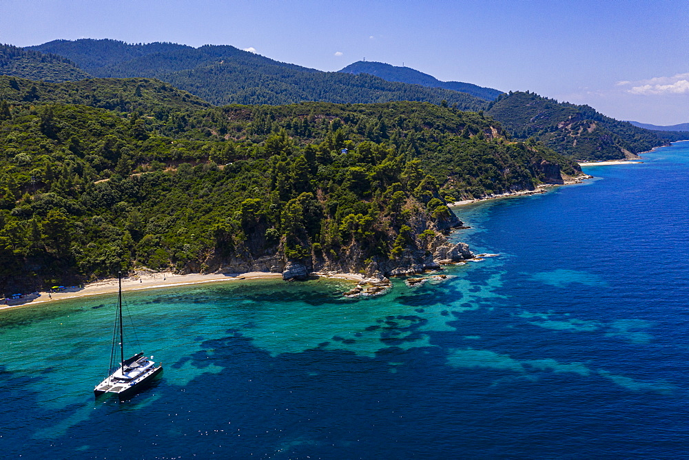Aerial of a sailing boat on Zografou Beach, Sithonia, Greece (drone)