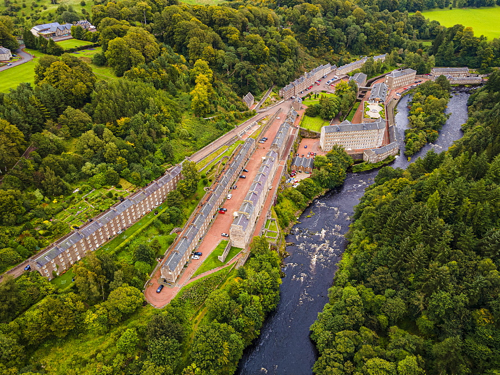 Aerial of the industrial town of New Lanark, UNESCO World Heritage Site, Scotland, United Kingdom, Europe - 1184-4795