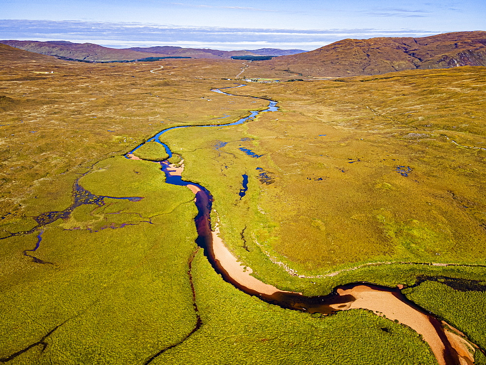 Aerial of a river snaking through the moor of the Black Cuillin ridge, Isle of Skye, Inner Hebrides, Scotland, United Kingdom, Europe - 1184-4824