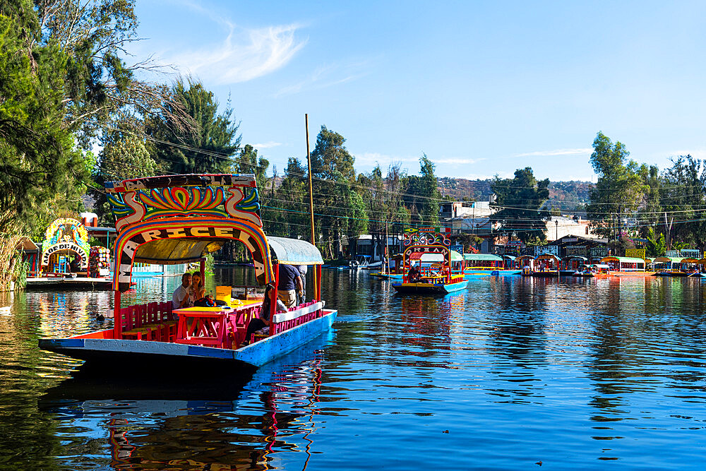Colourful boats on the aztec canal system, Unesco site Xochimilco, Mexico city, Mexico - 1184-5455