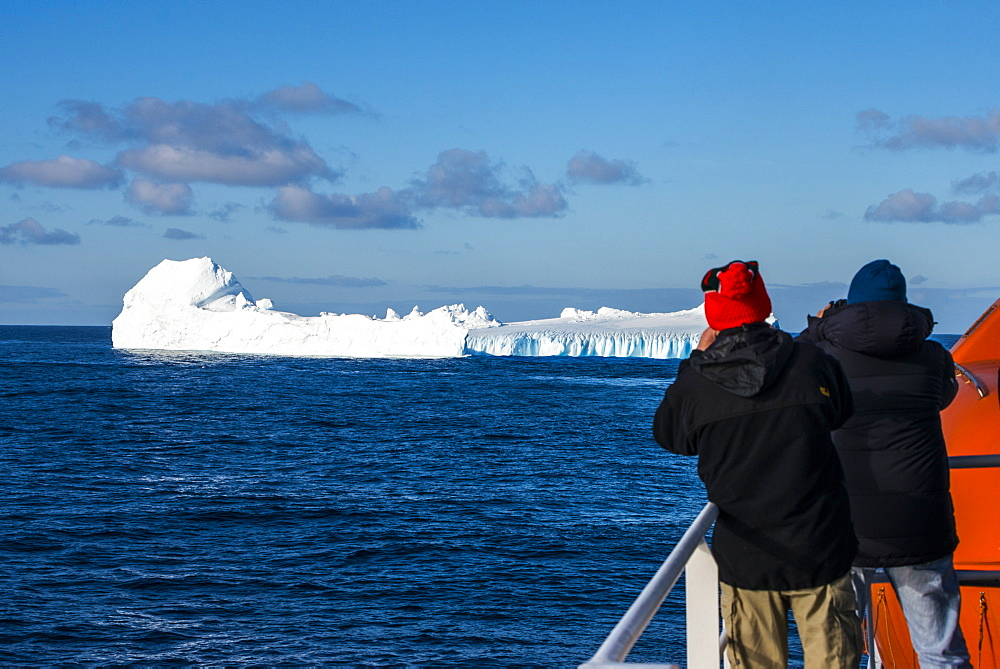 Tourists watching an iceberg floating in the South Orkney Islands, Antarctica, Polar Regions