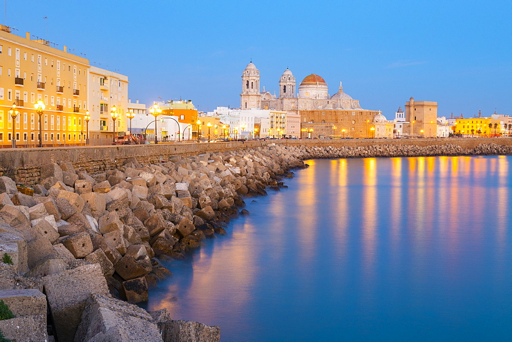 Santa Cruz Cathedral and ocean seen from the promenade along quayside, Cadiz, Andalusia, Spain