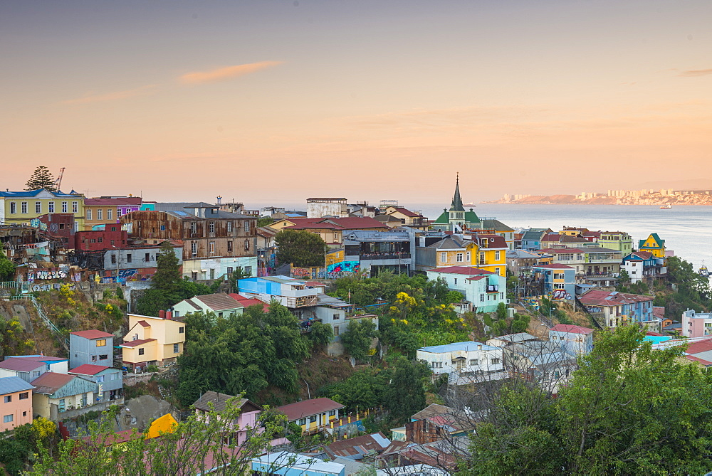 Sunset over the colourful buildings of Valparaiso, Chile, South America