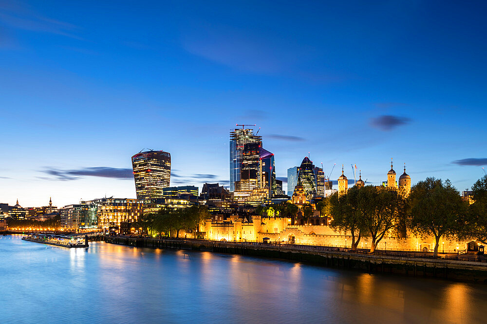 The city and tower of London at dusk reflecting in the river Thames - 1186-758