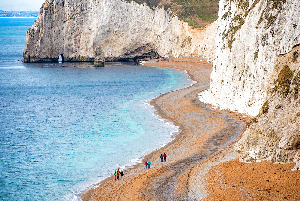 Tourists on Durdle Door beach on the Jurassic Coast, UNESCO World Heritage Site, Dorset, England, United Kingdom, Europe