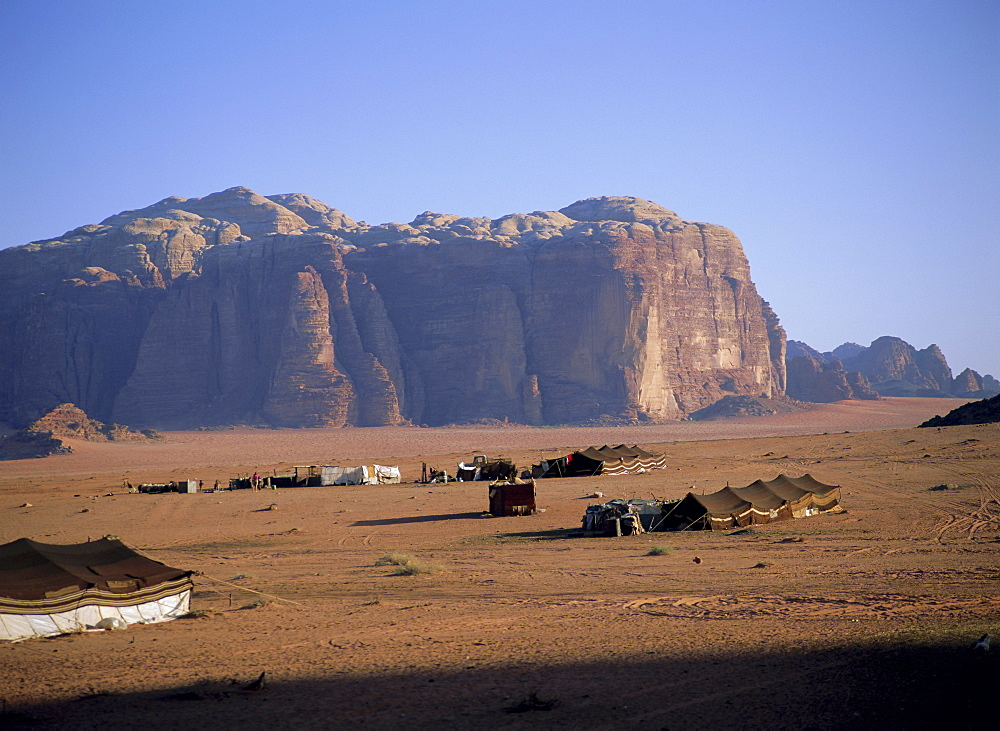 Bedu (Bedouin) tents at Abu Aineh, south of Rum village, with Jebel Khazali in the background, Wadi Rum, Jordan