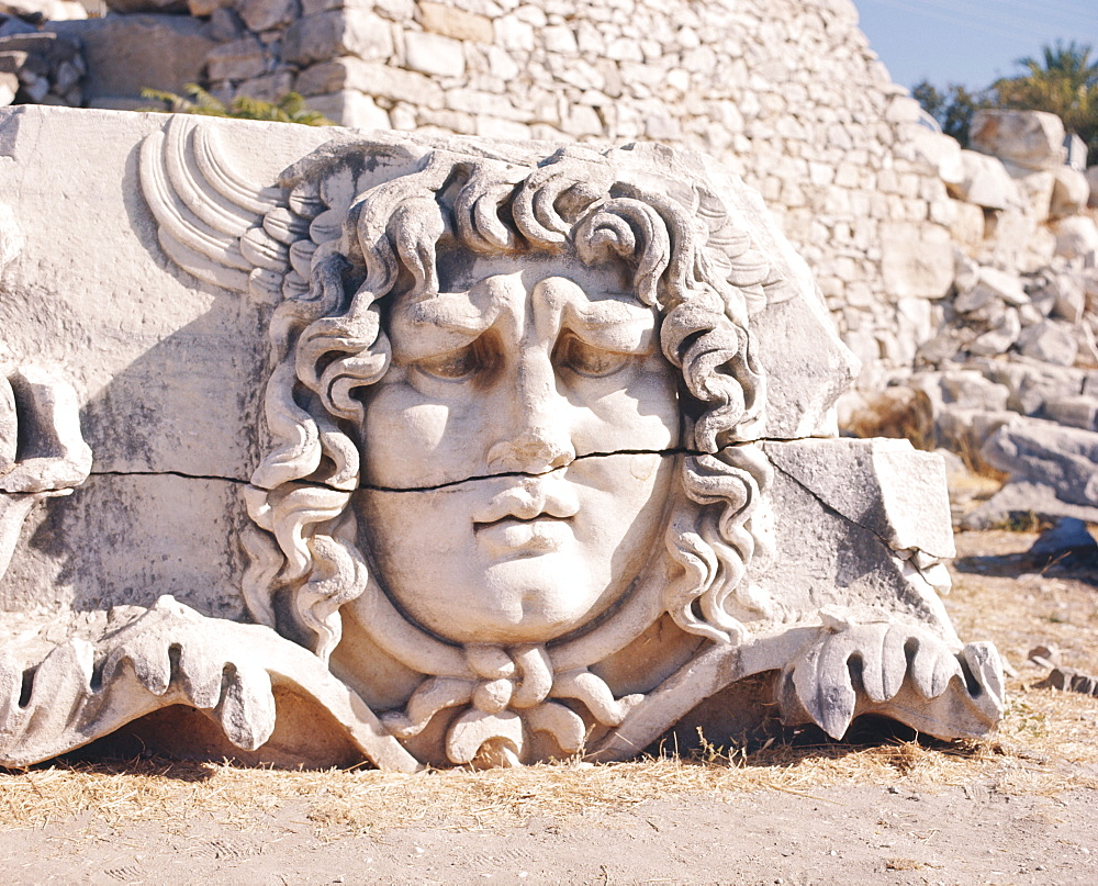 Carved head of Medusa at the archaeological site of Didyma , Turkey