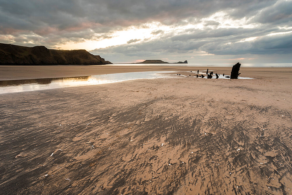 Beach and Helvetia shipwreck at low tide, Rhossili Bay, Gower Peninsula, South Wales.