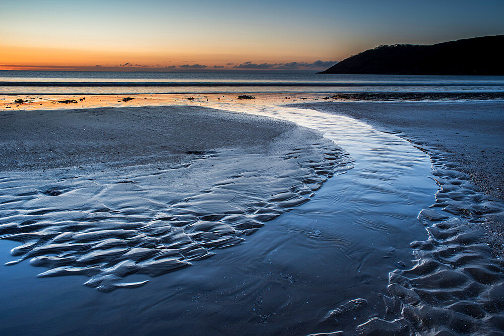 Oxwich beach at low tide at dawn, Gower Peninsula, South Wales