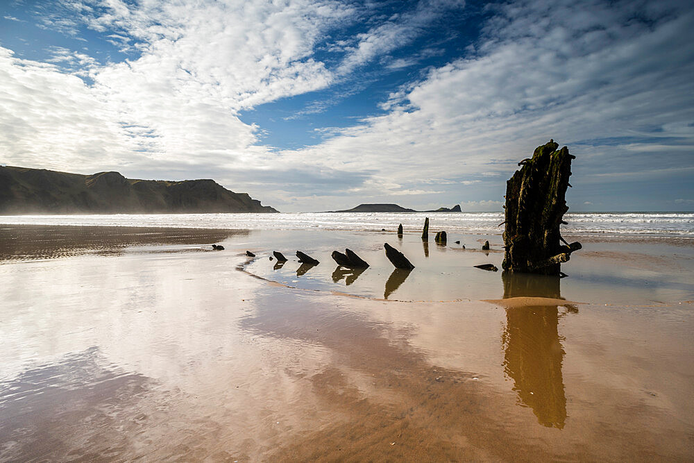 Helvetia shipwreck and clouds reflected in wet sand, at low tide, Rhossili Bay, Gower Peninsula, South Wales, United Kingdom, Europe - 1200-131