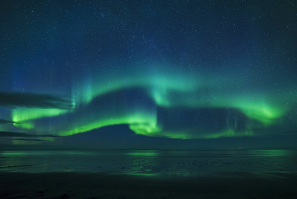 Aurora borealis (Northern Lights) reflected in ocean, North Snaefellsnes, Iceland, Polar Regions
