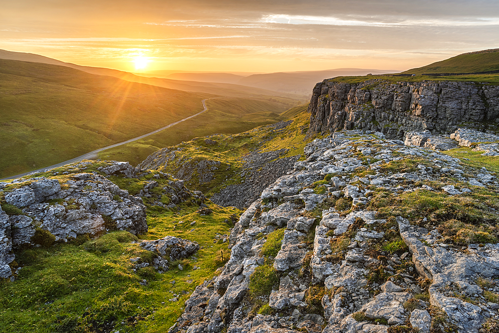 Limestone escarpment looking towards Oxnop Ghyll, at sunset, Yorkshire Dales, Yorkshire, England, United Kingdom, Europe