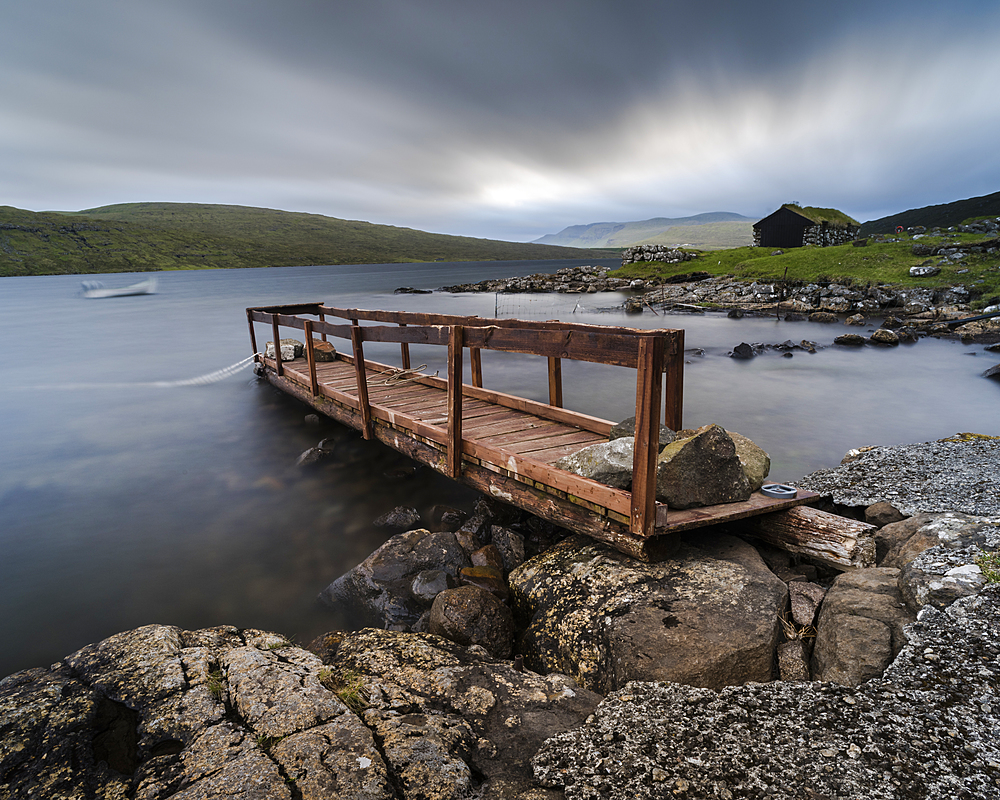 Wooden pier and boathouse on Lake Letisvatn, Vagar Island, Faroe Islands.