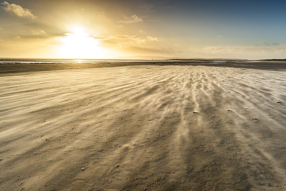Strong winds on Camber Sands beach, East Sussex, England.